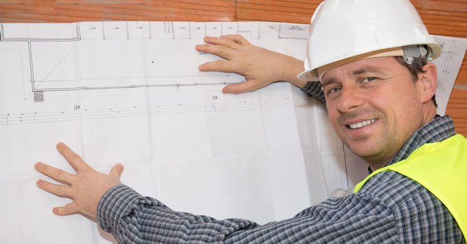 Contractor looking at building blue print